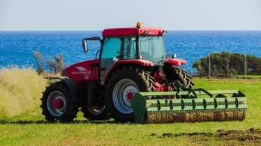 A generic image of a tractor towing a ridged roller.